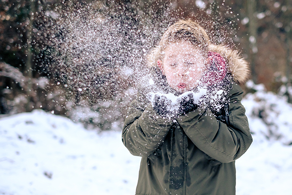 Young child playing with snow