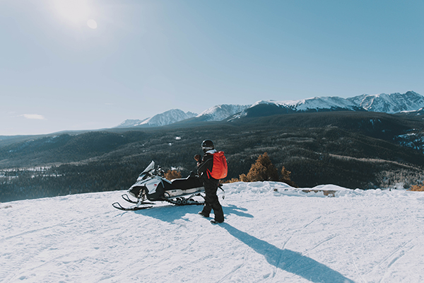 Person getting ready to ride snowmobile